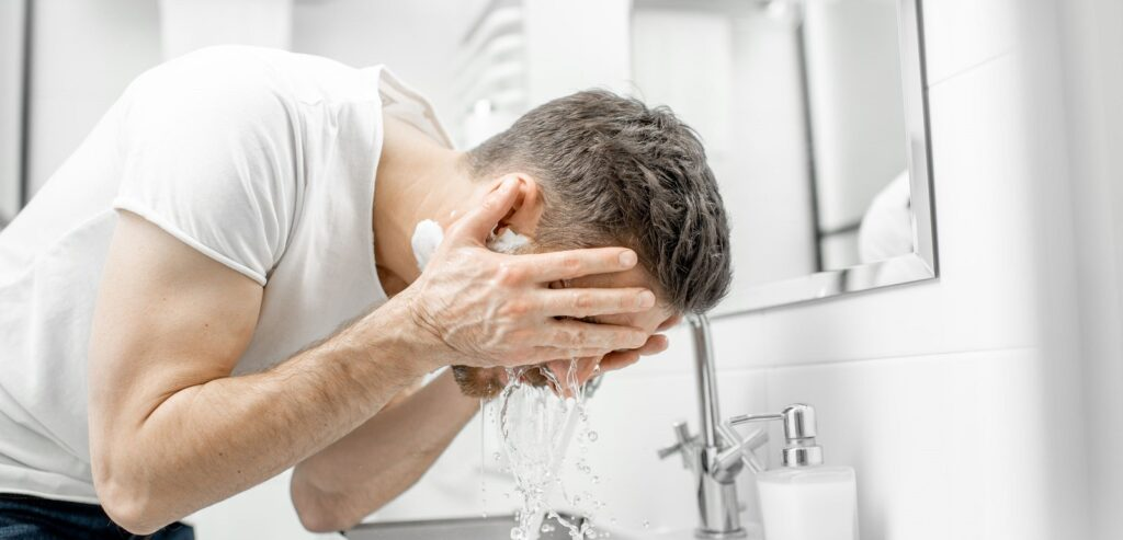 Man washing face in the bathroom